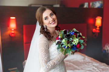 Smiling bride with wedding bouquet