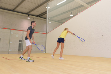 teamwork while playing squash