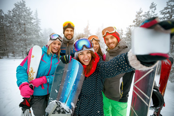 winter, extreme sport and people concept - Group of smiling friends making selfie