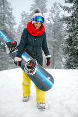 smiling young girl snowboarder