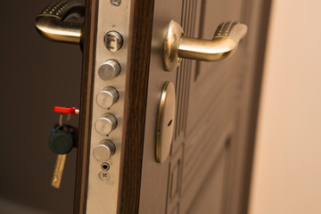 Closeup shot of modern door lock with a key. Empty space