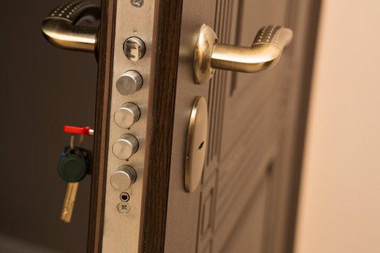 Closeup shot of modern door lock with a key. Empty space