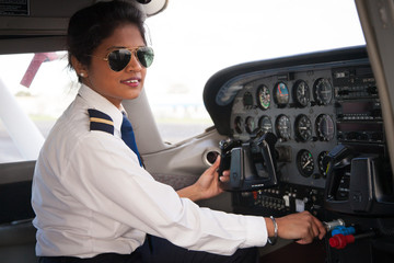 Female Pilot at the Aircraft Controls