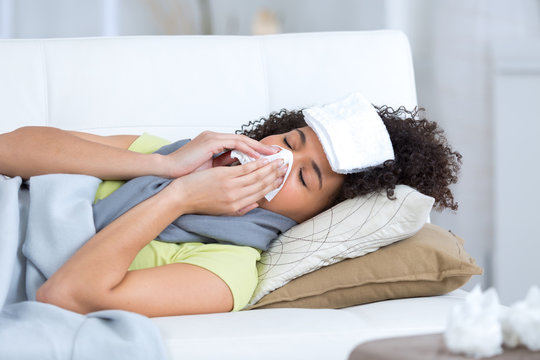 young woman sick on the sofa