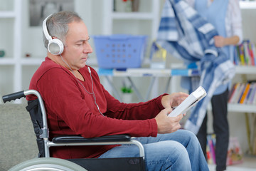 handicapped man wearing headset