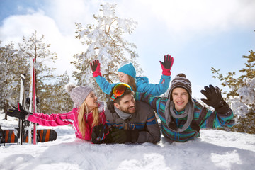 Happy family having fun on snow