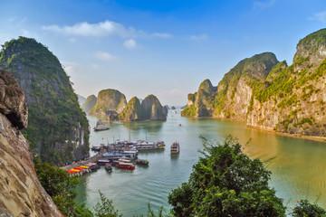 Junks and Floating village in Halong Bay, Vietnam.