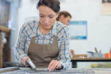 female artist creating in her workshop