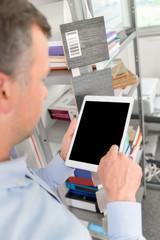 Designer using a tablet computer