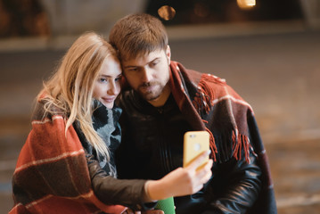 Young happy couple take selfie photos at camera on smart mobile cell phone