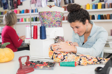 young dressmaker busy making a clothing