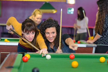 girls playing pool