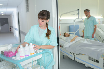 Nurse with trolley outside of patient's room