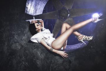 beautiful model posing in the Studio, big fan