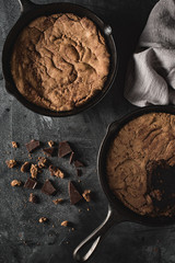 Chocolate chip cookies baked in a cast iron skillet.