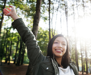 Happy Asian woman in the forest
