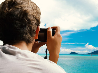 Backside of man taking photo on the beach, dicut concept.