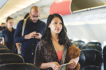 A girl traveling by airplane