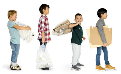 Group of little boys carrying trash to recycle