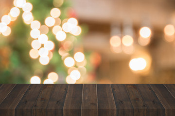 wooden plank with christmas light blurred background