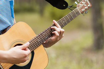 Musician romantic lifestyle guitar concept. Stroller man at the nature. Artist instruments.