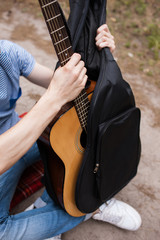 Music lifestyle man playing guitar concept. Stroller man at the nature. Artist instruments.