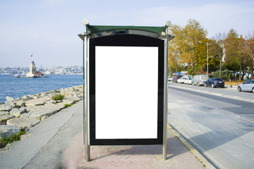 blank billboard for advertisement in a bus stop at the street in istanbul bosphorus on background maiden's tower