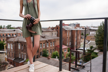 Urban photoshoot woman walk roof concept. Photographer work. In search of beautiful pictures.