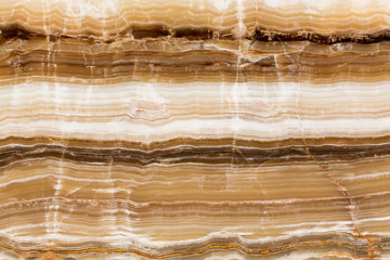 Beige patterned onyx natural stone backgorund.