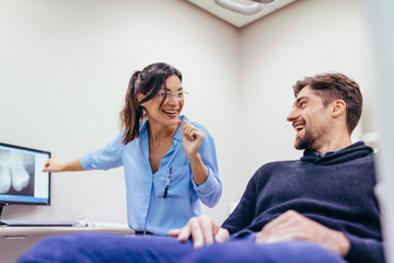 Man visiting female dentist at clinic
