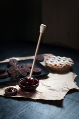 American Pie with cookies and jam. On a black plate