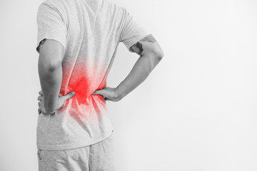 a man touching his back, with red highlight. Back pain, backache and waist pain, on white background with copy space