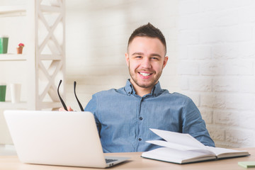 Smiling businessperson working on project