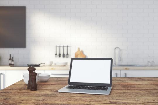 Empty white laptop on kitchen counter