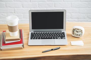Designer desk with empty laptop display