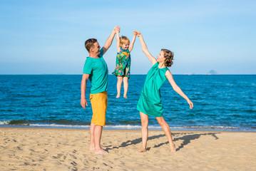 Happy family on the beach. Family look