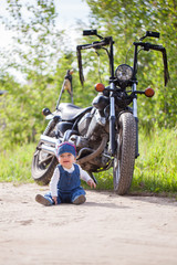 cute happy girl biker with a motorcycle bike on the road