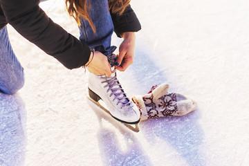 Girl in a new white skates for skating