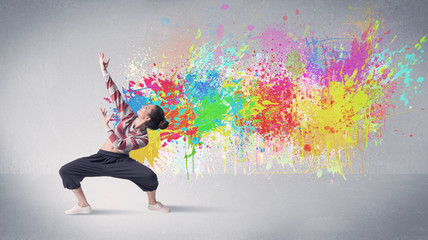 Young colorful street dancer with paint splash