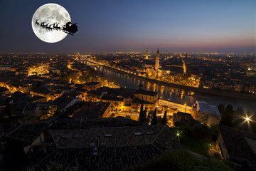 santa claus with reindeer over the city of verona