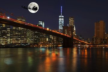 santa claus with reindeer over the city of new york