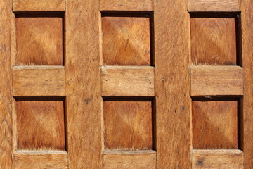 Polished old wooden texture with squares as a background