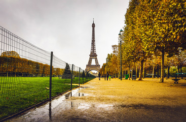 Eiffel tower in Paris at rainy autumn evening.