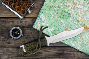 compass knife and map