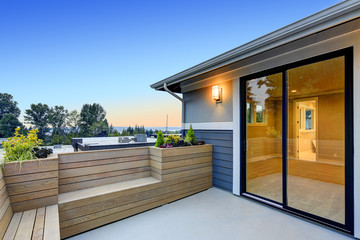 Contemporary deck with wood bench and planter boxes