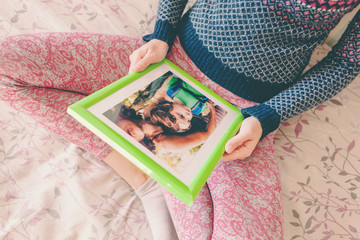 A woman looks at a photo.
