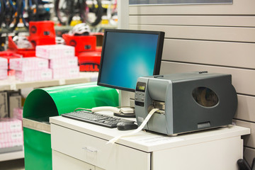 Computer for inventory of products with sticker printer in hardware store