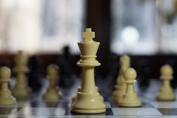 king queen and bishiop close up on a chess board