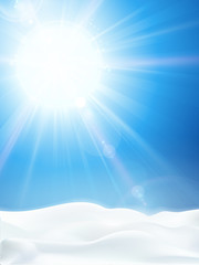 Bright clear blue winter sky with sun and snow landscape
