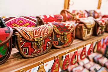 fabric female hand bags with ethno traditional patterns in clothing store, fashion accessories